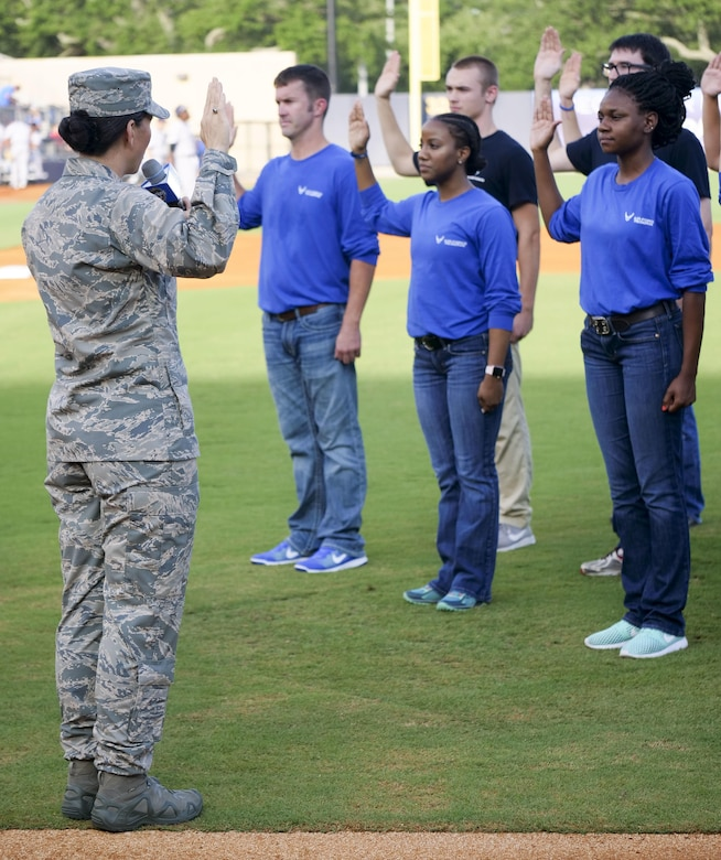 Col. Debra Lovette, 81st Training Wing commander, recites the oath of office to Air Force delayed enlistment program recruits during the Biloxi Shuckers Minor League Baseball team's military appreciation night July 8, 2017, in Biloxi, Miss. The Shuckers recognized and honored service members and their families for the dedication, commitment and sacrifices they make for the nation. (U.S. Air Force photo by Capt. David J. Murphy)