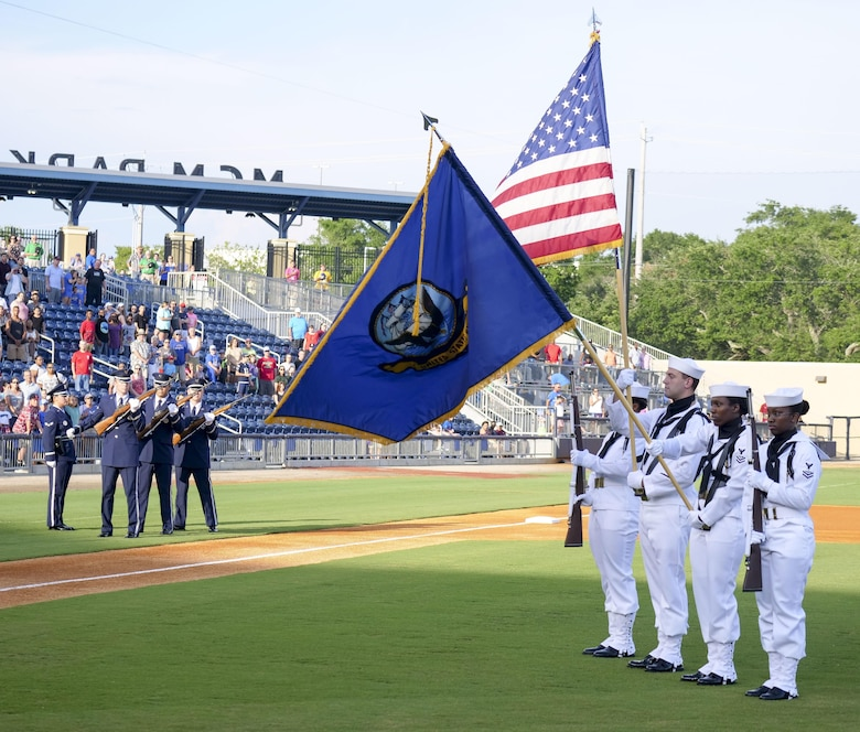 Keesler Air Force Base Honor Guard members perform a firing party during the Biloxi Shuckers Minor League Baseball team's military appreciation night July 8, 2017, in Biloxi, Miss. The Shuckers recognized and honored service members and their families for the dedication, commitment and sacrifices they make for the nation. 