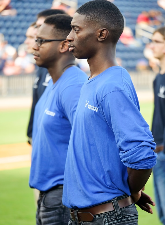 Carlas Hunt stands with other Air Force and Air Force Reserve delayed entry program members prior to reciting the oath of enlistment at the Biloxi Shucker's Military Appreciation Game at MGM Stadium in Biloxi, Miss., July 8, 2017. Hunt was one of 15 other DEP members who were sworn in by Col. Debra Lovette, 81st Training Wing commander. 