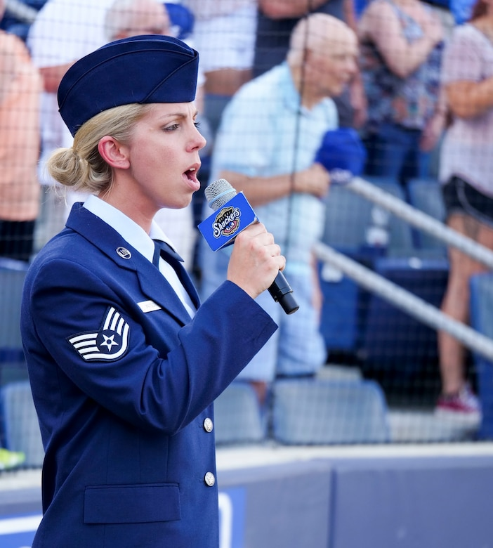 Staff Sgt. Jordan Watson, 41st Aerial Port Squadron transportation craftsman, sings the national anthem during the Biloxi Shuckers Minor League Baseball team's military appreciation night July 8, 2017, in Biloxi, Miss. The Shuckers recognized and honored service members and their families for the dedication, commitment and sacrifices they make for the nation. 