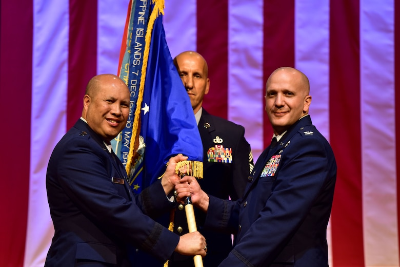 Col. Gerald Donohue accepts command of the 19th Airlift Wing from Lt. Gen. Giovanni Tuck, 18th Air Force commander, July 11, 2017 at Little Rock Air Force Base, Ark. The 19th AW is home to more than 6,000 Combat Airlift personnel and the world's largest C-130 base. (U.S. Air Force photo by Staff Sgt. Jeremy McGuffin)