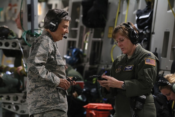 Lt. Col. Shari Ellis, 445th Aeromedical Evacuation Squadron flight nurse, shows Gen. Ellen Pawlikowski, Commander, Air Force Materiel Command, equipment AES Airmen use to communicate with each other during various missions they fly on. The general flew onboard a 445th Airlift Wing C-17 Globemaster III used for an aeromedical evacuation training flight June 20, 2017. (U.S. Air Force photo/Tech. Sgt. Patrick O'Reilly)