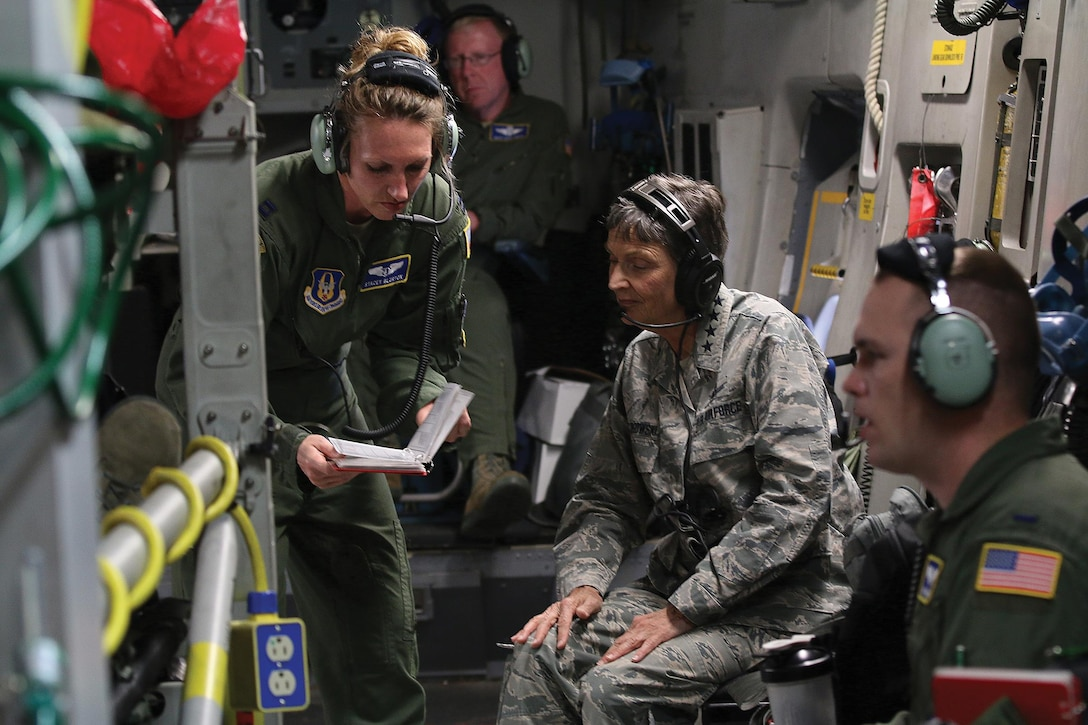 Capt. Stacey Blurton, 445th Aeromedical Evacuation Squadron flight nurse, explains to Gen. Ellen Pawlikowski, Commander, Air Force Materiel Command, the various checklists AES Airmen must follow for each flying mission during a training flight onboard a 445th Airlift Wing C-17 Globemaster III June 20, 2017. The general was shown the various equipment used by AES and saw the Airmen perform various medical emergency scenarios during the flight. (U.S. Air Force photo/Tech. Sgt. Patrick O'Reilly)