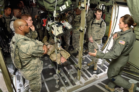 Capt. Kristen Parham (right), 36th Aeromedical Evacuation Squadron nurse, addresses a group of Air Force chaplain candidates during their tour of the 403rd Wing at Keesler Air Force Base, Mississippi, July 8, 2017. The candidates visited with several Air Force wings to get a better feel for how they support the Air Force mission and to meet with the Airmen that could interact with during their careers as chaplains. (U.S. Air Force photo/Tech. Sgt. Ryan Labadens)