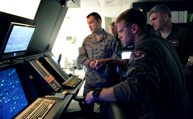 Col. William Denham, 14th Flying Training Wing Vice Commander, is shown the airfield from the perspective of the radar control room July 11, 2017, on Columbus Air Force Base, Mississippi. The Radar Approach Control room is where Air Traffic Controllers direct and coordinate flight paths for aircraft in flight.