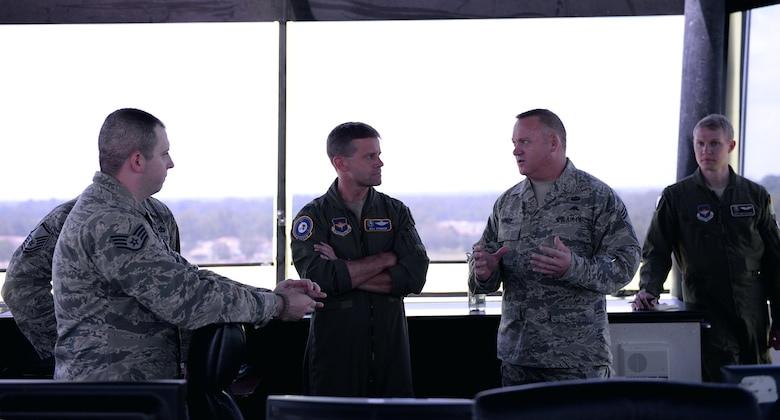Chief Master Sgt. Bradley Reilly, 14th Operations Group Superintendent and Col. William Denham, 14th Flying Training Wing Vice Commander discuss air traffic control in the control tower on Columbus Air Force Base, Mississippi, July 11, 2017. Columbus Air Traffic Controllers aid in the production of about 475 pilots annually and directly impact the Columbus AFB mission every day.