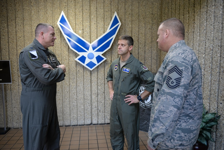 Col. William Denham, 14th Flying Training Wing Vice Commander, meets with Col. Stan Lawrie, 14th Operations Group Commander, and Chief Master Sgt. Bradley Reilly, 14th Operations Group Superintendent, for an immersion on July 11, 2017 at Columbus Air Force Base, Mississippi. Immersions are designed to let new commanders assess the unit and any problems, if any, associated with it. Immersions allow face to face conversation with the new commander.