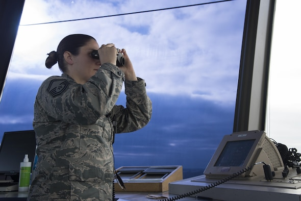 Senior Master Sgt. Leigh Watreas, a 375th Operations Support Squadron air traffic controller checks the runway March 25, 2016, at Scott Air Force Base, Illinois. The lives of those in the air heavily depend on Airmen on the ground. Responsible for managing the flow of aircraft through all aspects of their flight, Air Traffic Control specialists ensure the safety and efficiency of air traffic on the ground and in the air. (U.S. Air Force photo by Airman 1st Class Gwendalyn Smith)