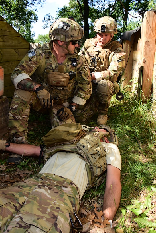 Tech. Sgt. Matthew Vandermolen, left, and Tech. Sgt. Erich J. Sanford, explosive ordnance disposal specialists with the Air National Guard's 115th Fighter Wing in Madison, Wis. provide emergency first aid to an injured team member during the Audacious Warrior exercise at Fort McCoy, Wis., July 27, 2017. The 12 day long exercise utilized the extensive training facilities of Volk Field Combat Readiness Training Center and Fort McCoy Total Force Training Center to provide EOD teams from eight different states comprehensive classroom and scenario based training in EOD tactics and procedures difficult to obtain at their respective home stations. (U.S. Air National Guard Photo by Master Sgt. Paul Gorman)