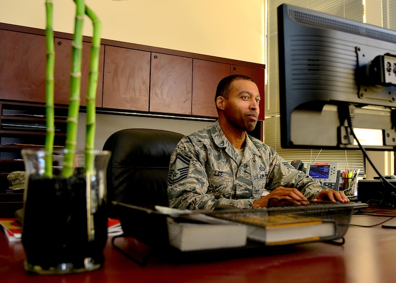 U.S. Air Force Senior Master Sgt. Michael Lee, 633rd Force Support Squadron career assistance advisor checks his daily taskings, at Joint Base Langley-Eustis, Va., June 29, 2017. Whether an Airman is active duty, in the Air National Guard or Air Force Reserve, they are able to go to the career assistance advisor for guidance.