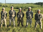 From left, Army Spc. Thomas Murton, Army Spc. Andrew Huff, Army Spc. Dakota Adams, Army Sgt. Terence Daniels and Army Spc. Darren Cruz, all with the 138th Signal Company, assisted in the retransmission shot as well as other communication networks during annual training at Fort Knox, Ky., and the Wendell H. Ford Regional Training Center in Greenville, Ky., June 3-9, 2017. Army photo