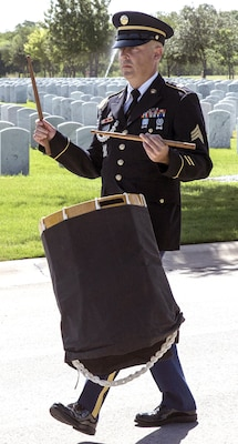 A member of the Joint Base San Antonio-Fort Sam Houston Honor Guard precedes the caisson carrying the remains of Army Cpl. Frank Sandoval. Sixty-six years after he was reported missing in action and died while serving in the Korean War, Sandoval was laid to rest in his hometown of San Antonio with military honors at Fort Sam Houston National Cemetery July 11.