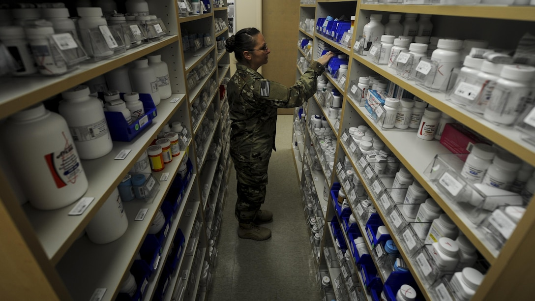 Tech. Sgt. Christina Easter, a pharmacy flight chief with the 1st Special Operations Medical Group, retrieves medication for prescription refill at Hurlburt Field, Fla., July 11, 2017. The 1st SOMDG supplies patients with a wide variety of medications including Motrin, Synthroid and Alegra-D. (U.S. Air Force photo by Airman 1st Class Dennis Spain)