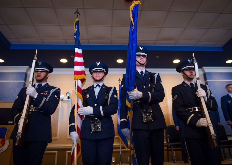 Honor Guard members prepare to present the colors at the 363rd Intelligence, Surveillance and Reconnaissance Wing change of command ceremony July 7, 2017. (U.S. Air Force Photo by Staff Sgt. Areca Bell)