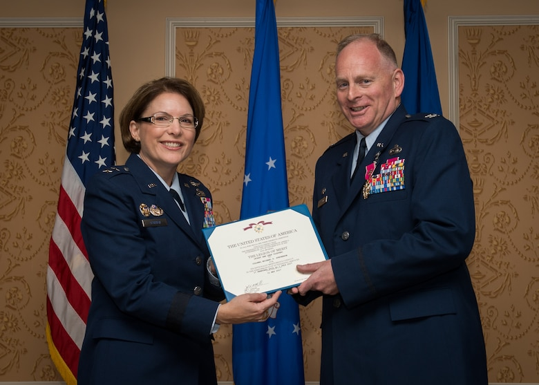 Maj. Gen. Mary F. O'Brien, commander, 25th Air Force, presents the Legion of Merit to Col. Michael Stevenson, outgoing commander, during the 363rd Intelligence, Surveillance and Reconnaissance Wing change of command ceremony July 7, 2017.  (U.S. Air Force Photo by Staff Sgt. Areca Bell)