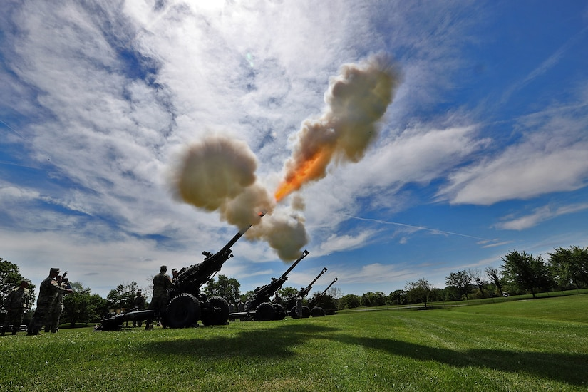 A salute battery assigned to Alpha Battery, 2nd Battalion, 122nd Field Artillery Regiment, Illinois Army National Guard, fires 105mm blank howitzer rounds at the 85th Support Command headquarters in Arlington Heights, Ill., July 9, 2017. Brig. Gen. Frederick R. Maiocco Jr., 85th Support Command commanding general, relinquished the command colors to Maj. Gen. Tracy A. Thompson, Deputy Commanding General for Support, U.S. Army Reserve. The Army Reserve's 85th Support Command, partnered with First Army, is made up of 46 Army Reserve battalions, nine brigade support elements, and nearly 4,300 Soldiers and Civilians spanning the continental United States and Puerto Rico. The units generate combat-ready units and Soldiers for the Army that are trained, equipped and lethal to win the nation's wars.  (U.S. Army photo illustration by Master Sgt. Anthony L. Taylor)