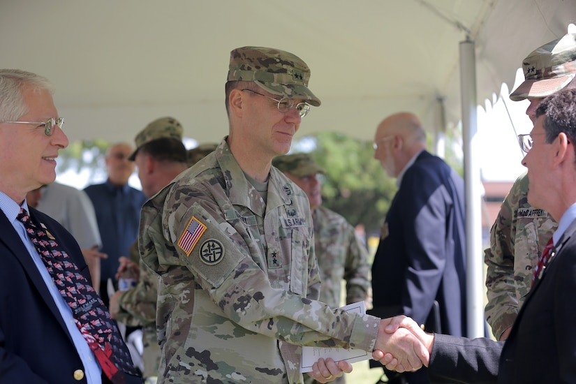 Maj. Gen. Chris R. Gentry, Deputy Commanding General for Support, First Army, shakes hands with Mayor Thomas Hayes, Mayor of Arlington Heights, after the 85th Support Command's relinquishment of command ceremony, July 9, 2017. The 85th Support Command, partnered with First Army, is made up of 46 Army Reserve battalions, nine brigade support elements, and nearly 4,300 Soldiers and Civilians that spanned across the continental United States and Puerto Rico, and generate combat ready units and Soldiers for the Army that are trained, equipped and lethal to win the nation's wars.  (U.S. Army photo by Master Sgt. Anthony L. Taylor)