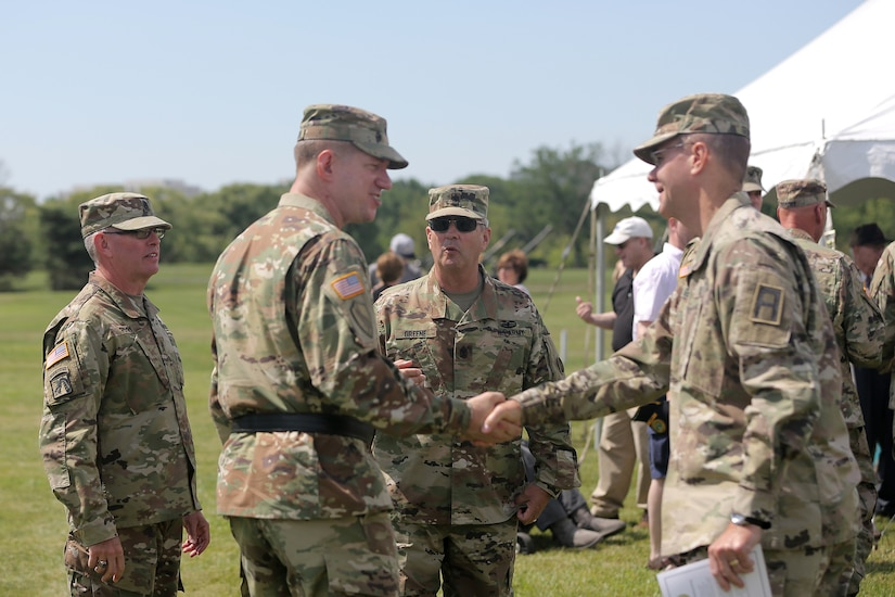 Maj. Gen. Tracy A. Thompson, left, Deputy Commanding General for Support, U.S. Army Reserve shakes hands with Maj. Gen. Chris R. Gentry, Deputy Commanding General for Support, First Army, after the 85th Support Command's relinquishment of command ceremony, July 9, 2017. The Army Reserve's 85th Support Command, partnered with First Army, is made up of 46 Army Reserve battalions, nine brigade support elements, and nearly 4,300 Soldiers and Civilians that spanned across the continental United States and Puerto Rico, and generate combat ready units and Soldiers for the Army that are trained, equipped and lethal to win the nation's wars.  (U.S. Army photo by Master Sgt. Anthony L. Taylor)