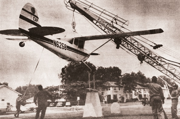 A Cessna L-19 or O-1 Bird Dog is placed on a display base in front of CAP National Headquarters in 1983, in memory of the CAP members who gave their lives in service to America. (courtesy photo)