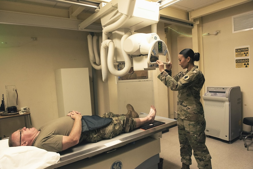 Sgt. 1st Class Trini Ta's Call to Duty as a radiology technician at Soto Cano Air Base includes providing service for Joint Task Force-Bravo personnel as well as military working dogs, ensuring providers get the right images to help their patients. Sgt. Ta receives a patient at the Medical Element July 5th, 2017.