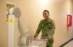 Sgt. 1st Class Trini Ta's Call to Duty as a radiology technician at Soto Cano Air Base includes providing service for Joint Task Force-Bravo personnel as well as military working dogs, ensuring providers get the right images to help their patients. Sgt. Ta moves radiology equipment at the Medical Element July 5th, 2017.