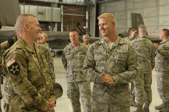 Army Command Sgt. Maj. John Troxell (left), Senior Enlisted Advisor to the Chairman of the Joint Chiefs of Staff, speaks with Airmen from the 57th Maintenance Group during a Nellis Air Force Base, Nev. visit July 10, 2017.  One of Troxell's many duties as SEAC is to monitor the pulse of the joint enlisted force by identifying trends in morale and readiness. (U.S. Air Force photo by Senior Airman Joshua Kleinholz)