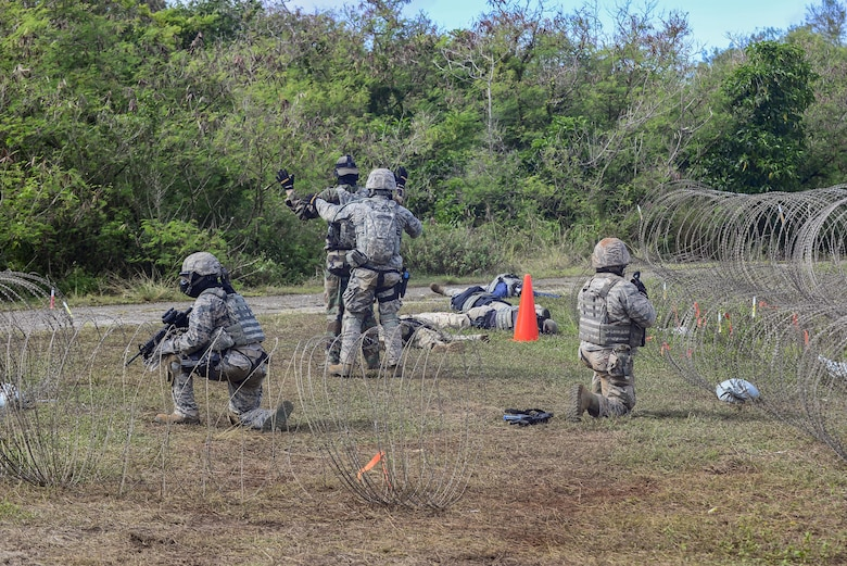 U.S. Air Force Airmen from the 644th Combat Communications Squadron captures an Airman acting as an opposing force during exercise Dragon Forge June 15, 2017, at Andersen South, Guam. Opposing forces repeatedly attacked the base throughout the day prior to an all-out final attack from all sides with the goal of overrunning the base. (U.S. Air Force photo by Airman 1st Class Christopher Quail)