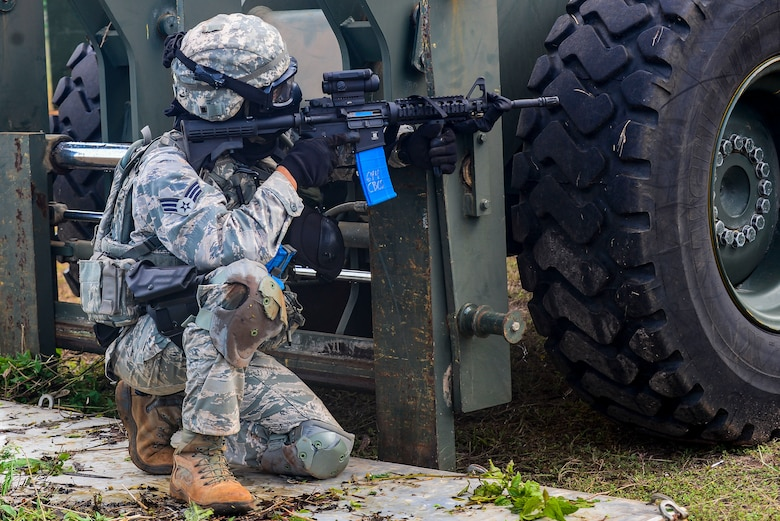 A U.S. Air Force Airman from the 644th Combat Communications Squadron takes cover behind a fork lift during exercise Dragon Forge June 15, 2017, at Andersen South, Guam. Opposing forces repeatedly attacked the base throughout the day prior to an all-out final attack from all sides with the goal of overrunning the base. (U.S. Air Force photo by Airman 1st Class Christopher Quail)