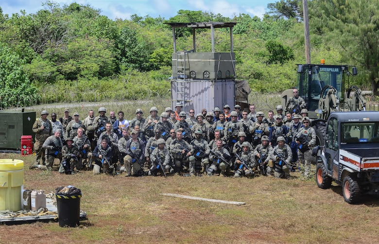 The 644th Combat Communication Squadron poses for a group photo after exercise Dragon Forge June 15, 2017, at Andersen South, Guam. Exercise Dragon Forge is a 164-hour training exercise designed to teach, train and build combat skills, while instilling the warrior ethos into CBCS Airmen. (U.S. Air Force photo by Airman 1st Class Christopher Quail)