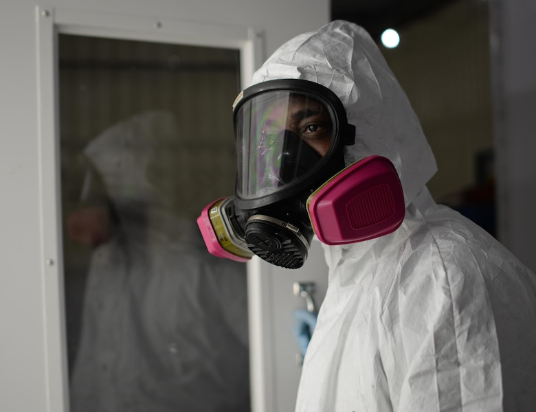 Senior Airman Jeremy Washington, 374th Maintenance Squadron aircraft structural journeyman, deployed from Yokota Air Base, Japan, walks into a sanding room in the new temporary corrosion control facility at Andersen Air Force Base June 27, 2017. Made of shipping containers, the facility meets all requirements set forth by the Department of Defense and Occupational Safety and Health Agency. (U.S. Air Force photo by Senior Airman Alexa Ann Henderson)
