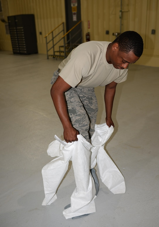 Senior Airman Jeremy Washington, 374th Maintenance Squadron aircraft structural journeyman, deployed from Yokota Air Base, Japan, suits up in preparation for sanding down a weapons trailer June 29, 2017, at Andersen Air Force Base, Guam. Airmen began work in a new temporary corrosion control facility while a new project for a permanent facility is underway. (U.S. Air Force photo by Senior Airman Alexa Ann Henderson)