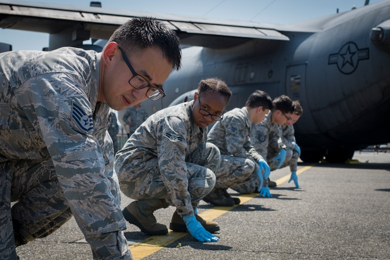 Airmen assigned to the 374th Force Support Squadron participate in a major accident response exercise, June 10, 2017, at Yokota Air Base, Japan. The training helps Airmen respond to a crisis situation they may face during a large casualty accident. (U.S. Air Force photo by Airman 1st Class Juan Torres)
