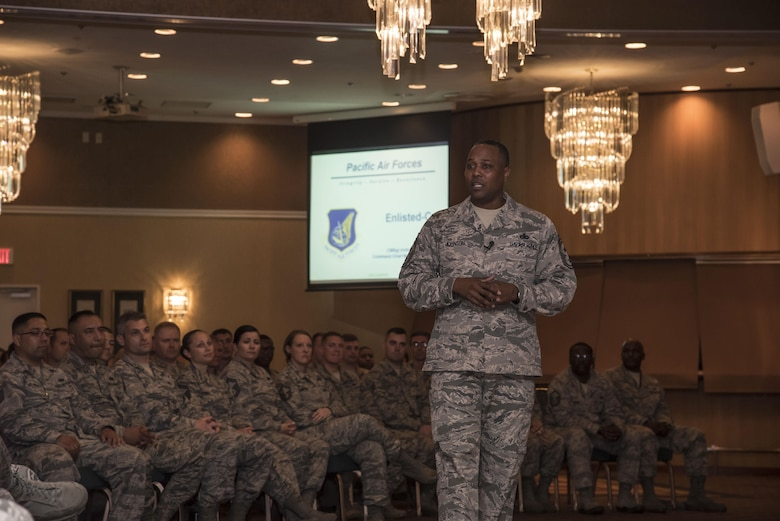 U.S. Air Force Chief Master Sgt. Anthony Johnson, the Pacific Air Forces' command chief, speaks during an elisted all call at Misawa Air Base, Japan, July 12, 2017. Johnson is touring all bases withing the PACAF major command to familiarize himself with each unit and identify challenges preventing Airmen from performing at their optimal level. (U.S. Air Force photo by Airman 1st Class Sadie Colbert)