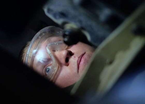 Senior Airman Austin, 380th Expeditionary Maintenance Squadron aerospace ground equipment journeyman, searches for an oil filter July 12, 2017, at an undisclosed location in southwest Asia.  AGE flight members work 24/7 overcoming obstacles in the AOR to ensure equipment needed to launch aircraft are always ready when needed. (U.S. Air Force photo by Senior Airman Preston Webb)