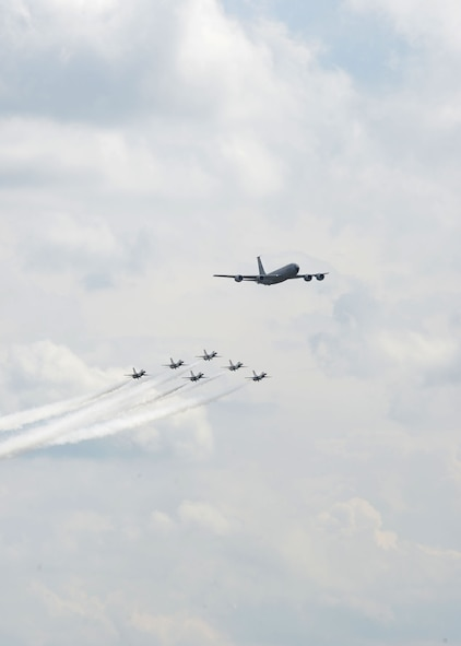 A KC-135 Stratotanker from the 100th Air Refueling Wing leads the U.S. Air Force Thunderbirds as they fly in formation July 10, 2017, over RAF Mildenhall and RAF Lakenheath, England. The elite flying display team were in the area on their way to the Royal International Air Tattoo at RAF Fairford, and practice for Bastille Day events in France. (U.S. Air Force photo by Karen Abeyasekere)