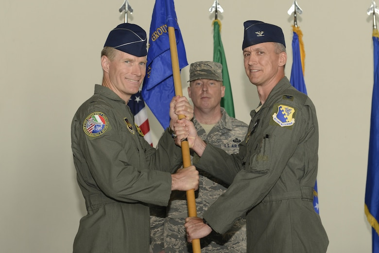 Col. Richard Nelson took command of the 31st Operations Group from Col. Craig Hollis during a change of command ceremony, July 10, 2017, at Aviano Air Base, Italy. Brig. Gen. Lance Landrum, 31st Fighter Wing commander, presided over the event. (U.S. Air Force photo by Tech. Sgt. Andrew Satran)