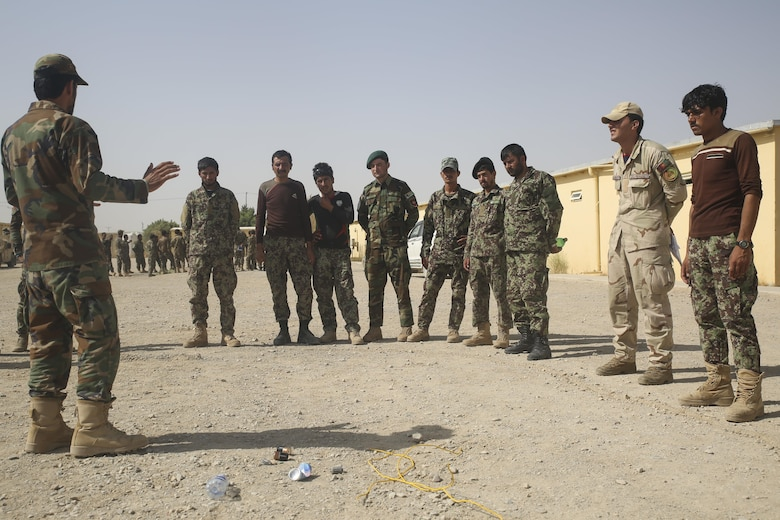 An Afghan National Army soldier with 215th Corps instructs his fellow soldiers on indicators of improvised explosive devices at Camp Shorabak, Afghanistan, July 13, 2017. Approximately 70 engineer soldiers with various units from the 215th Corps began a route clearance course July 8 with assistance from U.S. Marine advisors assigned to Task Force Southwest. The eight-week course is designed to bolster the soldiers' route clearance capabilities to help promote maneuverability amongst infantry kandaks and supplies in Helmand Province. (U.S. Marine Corps photo by Sgt. Lucas Hopkins)