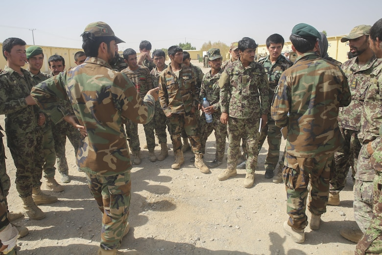 An Afghan National Army soldier with 215th Corps demonstrates disturbed earth patterns, a possible indicator of an improvised explosive device, at Camp Shorabak, Afghanistan, July 13, 2017. Approximately 70 soldiers with various units from 215th Corps recently began a route clearance course, which instructs students on proper counter IED procedures, helping to promote the maneuverability of infantry kandaks, supplies and civilians throughout Helmand Province. (U.S. Marine Corps photo by Sgt. Lucas Hopkins)