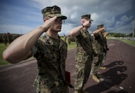 U.S. Marine Cpls. Otto Thiele, Eric Goodman, and Christopher Ehms and Lance Cpl. Avelardo Guevera Osuna receive Navy Achievement Medals from Col. Forrest Poole aboard Camp Kinser, Okinawa, Japan, July 11, 2017. The Marines came together to assist a local Japanese woman during their hike on Mount Fuji, Japan, July 3, 2017. The woman, Moe Oda, was found lying on the ground, hyperventilating and struggling to breathe when the Marines came to her assistance. Together, they created a makeshift stretcher to carry her down approximately two miles to get to medical assistance. The Marines are with Electronics Maintenance Company, 3d Maintenance Battalion, Combat Logistics Regiment 35, 3d Marine Logistics Group, III Marine Expeditionary Force.
