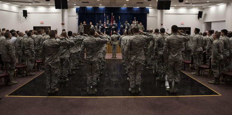 U.S. Airmen assigned to the 39th Air Base Wing, salute the colors during the 39th Mission Support Group change of command ceremony July 13, 2017, at Incirlik Air Base, Turkey. A change of command ceremony is a tradition that represents a formal transfer of authority and responsibility from the outgoing commander to the incoming commander. (U.S. Air Force photo by Airman 1st Class Devin M. Rumbaugh)