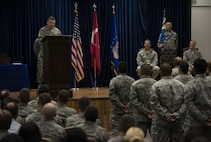 U.S. Air Force Col. David Williams Jr., 39th Mission Support Group incoming commander, speaks with a group of airmen after assuming command, July 13, 2017, at Incirlik Air Base, Turkey. A change of command ceremony is a tradition that represents a formal transfer of authority and responsibility from the outgoing commander to the incoming commander. (U.S. Air Force photo by Airman 1st Class Devin M. Rumbaugh)