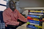 Saplay Seke, a business process analyst in DLA Troop Support's audit readiness office, facilitated a process-improvement event to address an issue related to how DLA employees communicate the status of transactions in their business software. His efforts led to a cost avoidance of $243,000 over three years. Photo by Shawn J. Jones