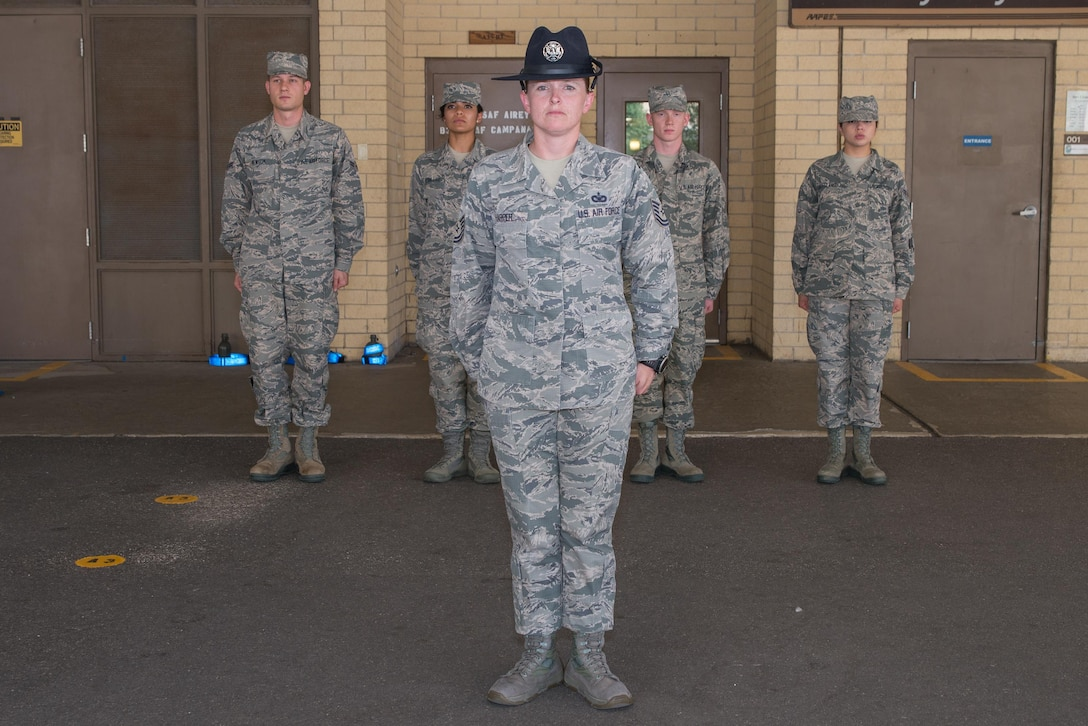 Tech. Sgt. Megan Harper stands at attention with Airman under the overhang at the 326th Training Squadron at Joint Base San Antonio-Lackland, Texas. June 28, 2017. Harper has been selected as the Military Times' 2017 Airman of the Year for her exceptional service over the course of a 15-year Air Force career.