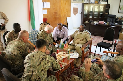 Brig. Gen. Benjamin F. Adams III and State Command Sgt. Maj. David Munden visit with Col. Mohamed Ali Obsieh, the Director General de l'Academie Militare InterArmees for the Djiboutian military in support of the State Partnership Program between the Kentucky National Guard and the nation of Djibouti at Arta-Amia, Djibouti, June 24, 2017.