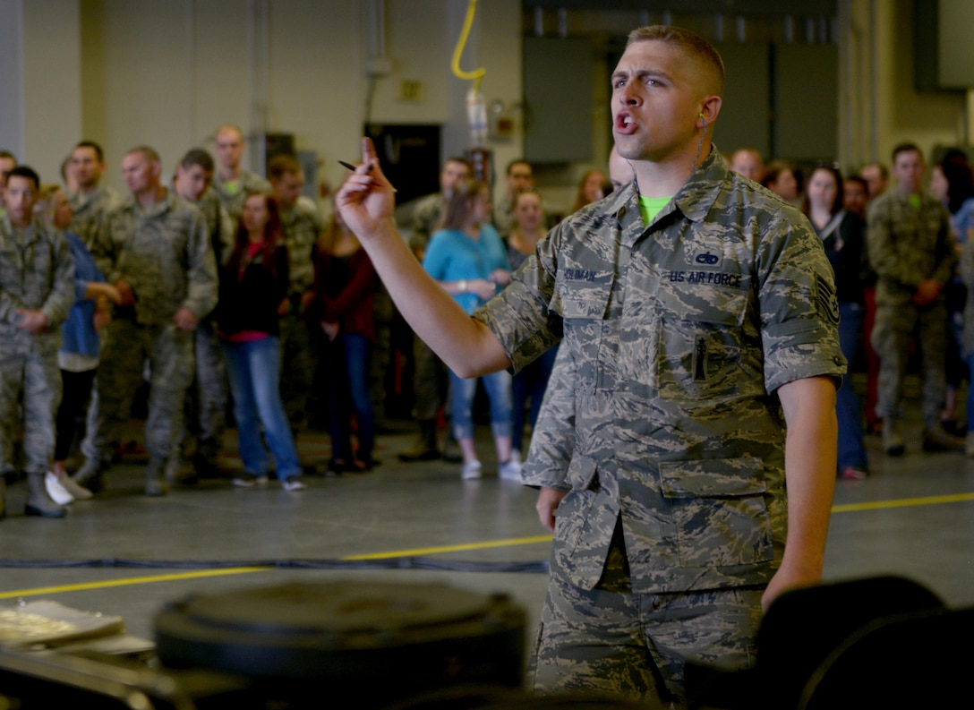 Staff Sgt. Eldin Holman, 705th Munitions Squadron weapons maintenance team chief, directs to his team during Global Strike Challenge at Minot Air Force Base, N.D., June 30, 2017. Holman and his team conduct a mate-and-tow maneuver during Global Strike Challenge 2017. (U.S. Air Force photo by Staff Sgt. Chad Trujillo)