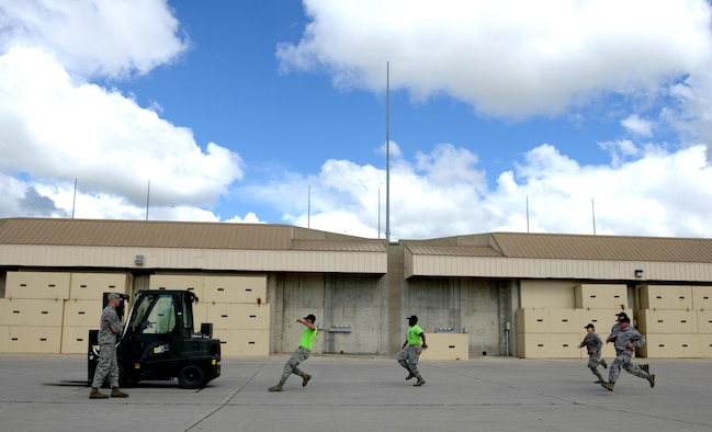 Members from the 705th Munitions Squadron kick off the forklift rodeo during Global Strike Challenge at Minot Air Force Base, N.D., June 30, 2017. The Airmen were evaluated on precision, speed and accuracy, the fork lift rodeo was one of many events during Global Strike Challenge 2017. (U.S. Air Force photo by Staff Sgt. Chad Trujillo)