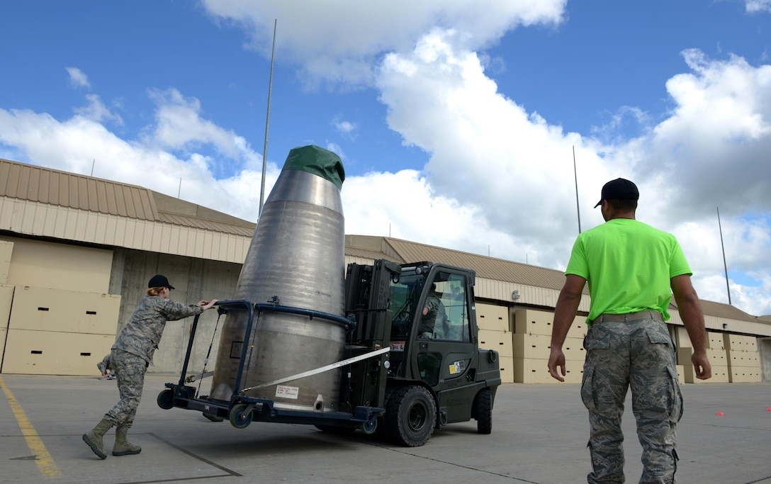 Re-entry system and re-entry vehicle maintenance members from the 705th Munitions Squadron transport an aft shroud during a forklift rodeo at Minot Air Force Base, N.D., June 30, 2017. The forklift rodeo was part of many events during Global Strike Challenge 2017. (U.S. Air Force Photo by Staff Sgt. Chad Trujillo)