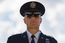 U.S. Air Force Brig. Gen. Bradley D. Spacy, Installation and Mission Support Center commander, stands at attention during a demonstration of the U.S. Air Force Honor Guard at Joint Base San Antonio-Lackland, Texas July 7, 2017. Spacy was the commander of the Honor Guard in Fresno, Calif.