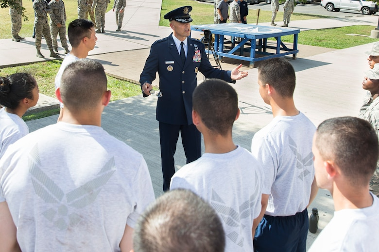 U.S. Air Force Brig. Gen. Bradley D. Spacy, Installation and Mission Support Center commander, talks with airmen from the 343rd Training Squadron after a demonstration of the U.S. Air Force Honor Guard at Joint Base San Antonio-Lackland, Texas July 7, 2017. Spacy was the commander of the Honor Guard in Fresno, Calif.
