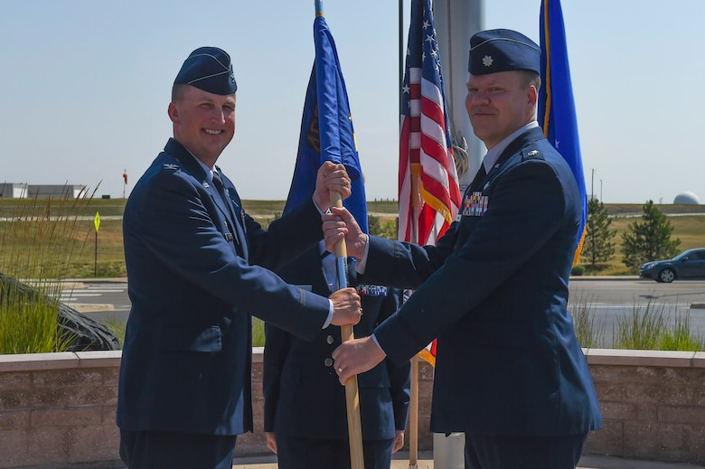 Lt. Col. Andrew Herman, 460th Medical Support Squadron incoming commander, receives the guidon, symbolizing the official change of command July 7, 2017, on Buckley Air Force Base, Colo. The 460th MDSS provides all administration, information systems and communication, resource management, logistical and facility management, and readiness for the Buckley community. (U.S. Air Force photo by Senior Airman Luke Nowakowski/Released)